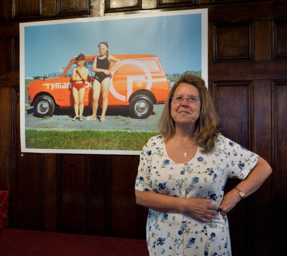 Cheryl Aston with a photographer of herself and brother Gary taken 40 years ago, exhibited at Haden Hill House Museum